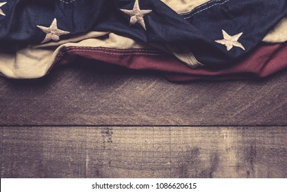 A vintage American flag or bunting on a wooden background with copy spacae