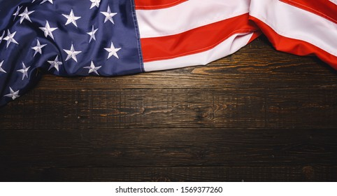 Vintage American flag on a dark wood planks with copyspace for your individual text. Backround or backfrop