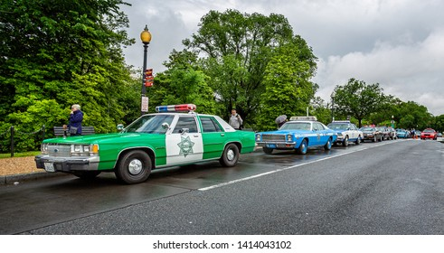 Vintage American Highway Patrol police cars parked outside The Jefferson memorial in Washington, DC, USA on 13 May 2019