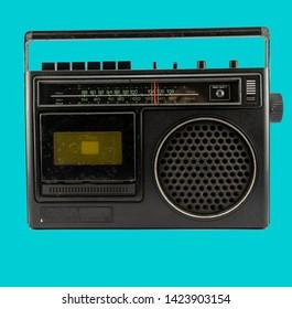 vintage AM/FM Cassette on a blue back ground