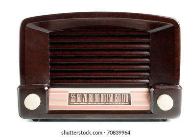 Vintage AM/FM radio on white, front view