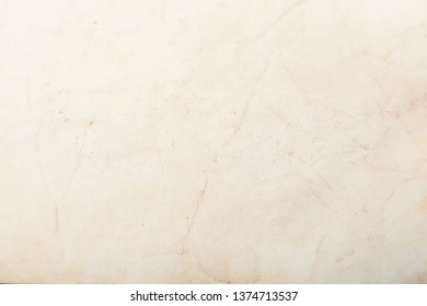 Vintage and antique background frame art concept. Front view of blank old aged dirty photo paper texture with stains and scratches. Detailed closeup studio shot