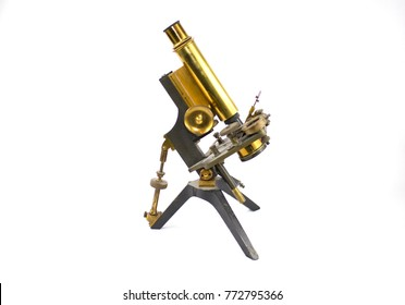 Vintage Antique Brass Microscope on White Background