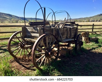 Vintage antique covered wagon in American prairie grassland