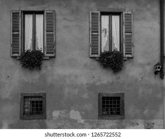 Vintage antique peeled building facade wall. Windows with blinders and decor. Classic European architecture. Postcard concept. Travel inspiration. Luxury estate background. Film effect