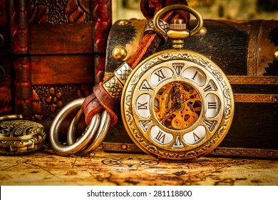 Vintage Antique pocket watch. Vintage grunge still life.