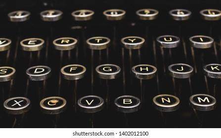 Vintage antique typewriter keys on a black background isolated