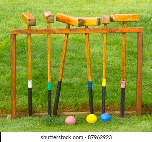 A vintage antique wooden croquet set on grass