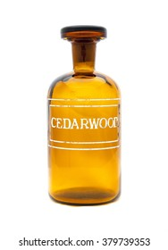 a vintage apothecary jar with cedarwood etched on front