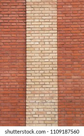 vintage architectural background - red brick wall with beige masonry stripe