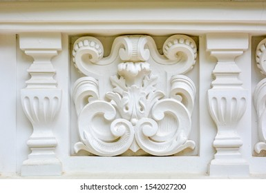 Vintage architectural stucco molding decorations of buildings wall texture. Old antique plaster molding and patterns. Wall border ornament with column as architecture building detail facade decor
