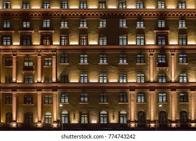 Vintage architecture classical facade illuminated at night. Front view close up.