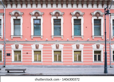 Vintage architecture classical facade old two storey building front close-up view.