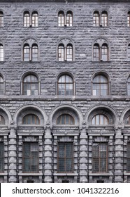 Vintage architecture classical rustic stone facade. Front view close up.