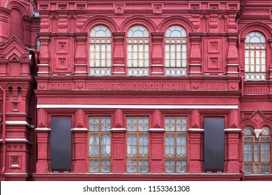 Vintage architecture red brick classical facade in.pseudo-Russian style.  Front view close up