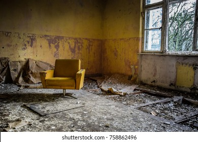 Vintage armchair in an abandoned room