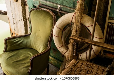 Vintage armchair and lifesaver in old venetian bookshop, Italy