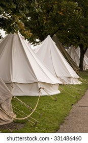 vintage army tents in a field