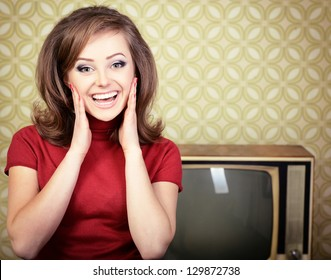 vintage art portrait of young smiling woman looking out at camera in room with wallpaper and tv set from 70s, retro stylization, toned