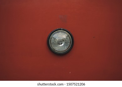 vintage artistic picture of old tram headlamp on tram frame red shabby surface background, copy space