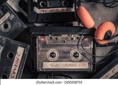 Vintage audio cassette with headphones and red walkman