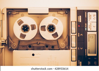 vintage audio tape compact cassette, sepia tone with artistic film noise