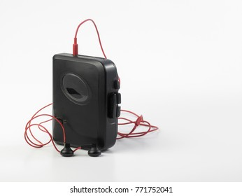Vintage audiotape mobile cassette player on white background