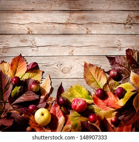 Vintage Autumn border from ashberry and and fallen leaves on old wooden table/ Thanksgiving day concept