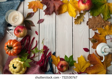 Vintage autumn border from fallen leaves on the old wooden table. Thanksgiving autumn background