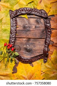 Vintage autumn fallen leaves frames on the old wooden table