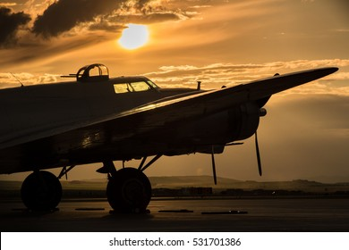Vintage B-17 Bomber Silhouetted by a sunset