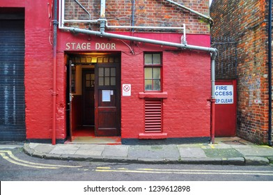 """Vintage back door to the stage with the inscription """"Stage door"""""""