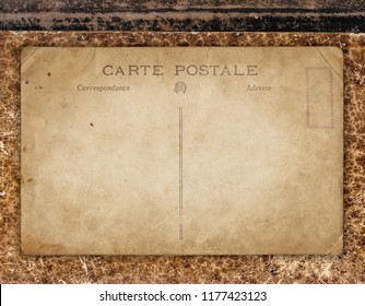 Vintage background with aged retro postcard on old book cover