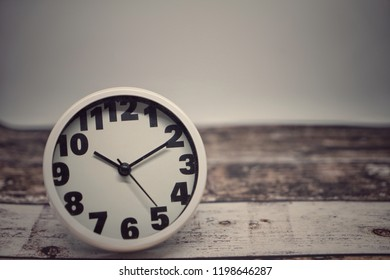 Vintage background with alarm clock on table. selective focus. copy space for text.