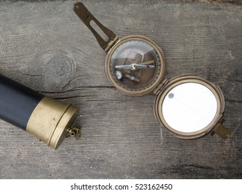 vintage background with compass and telescope