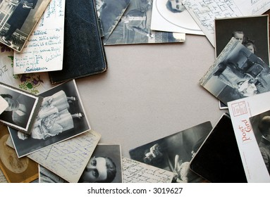 Vintage background with a frame of old postcards, old family photos and old notebooks