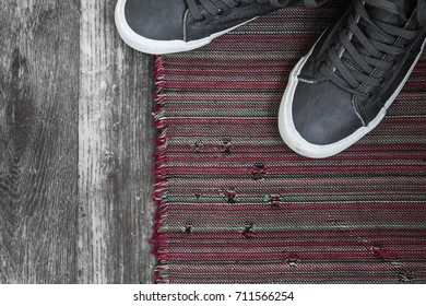 Vintage background with grey sneakers on the carpet