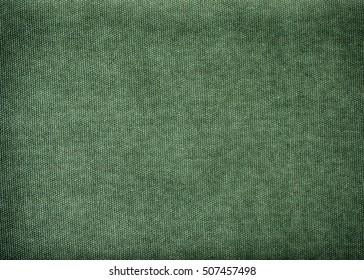 Vintage background mad of olive, green cotton with vignette
