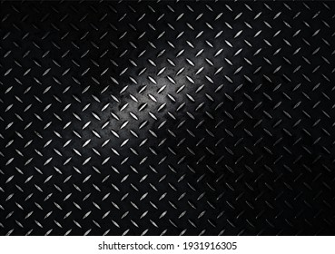 Vintage background of metal diamond plate in a dark gray color. A bright spot of light in the center. Top view, copy space.