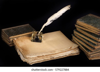 Vintage background with old ink bottle, books, papers and quill