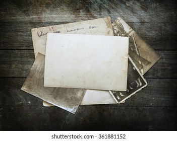 Vintage background with old paper and letters on wood