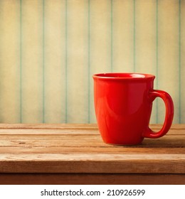 Vintage background with red coffee mug