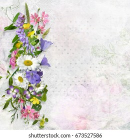 Vintage background with space for text or photo and a bouquet of summer meadow flower
