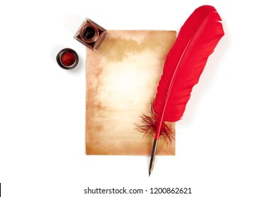 A vintage background with a vibrant red quill on a piece of old paper, with an ink well, on white with a place for text, top shot