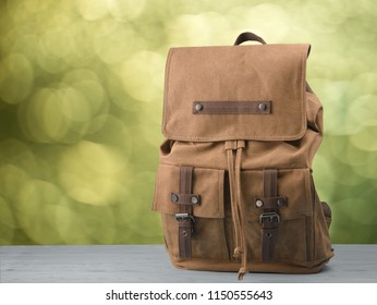 Vintage backpack on a natural background