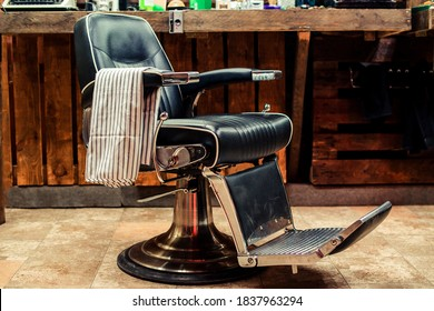 Vintage barber chair. Barbershop business. Barber shop chair. Modern hairdresser and hair salon. Barber shop for men. Barbershop theme. Barbershop interior. Stylish vintage barber chair.