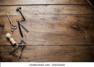 Vintage barber shoop tool on old wood background desk with place for text