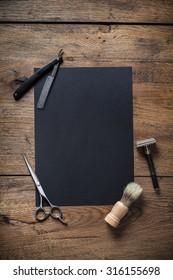 Vintage barber shoop tools with black poster paper