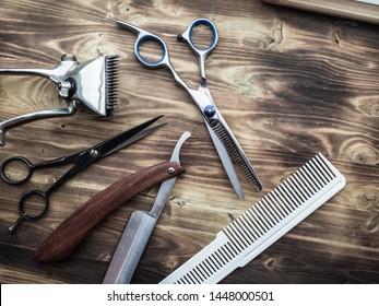 vintage barber shop tools on wood background
