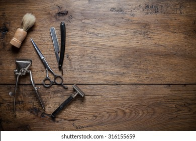 Vintage barber shop tools on wood background with place for text